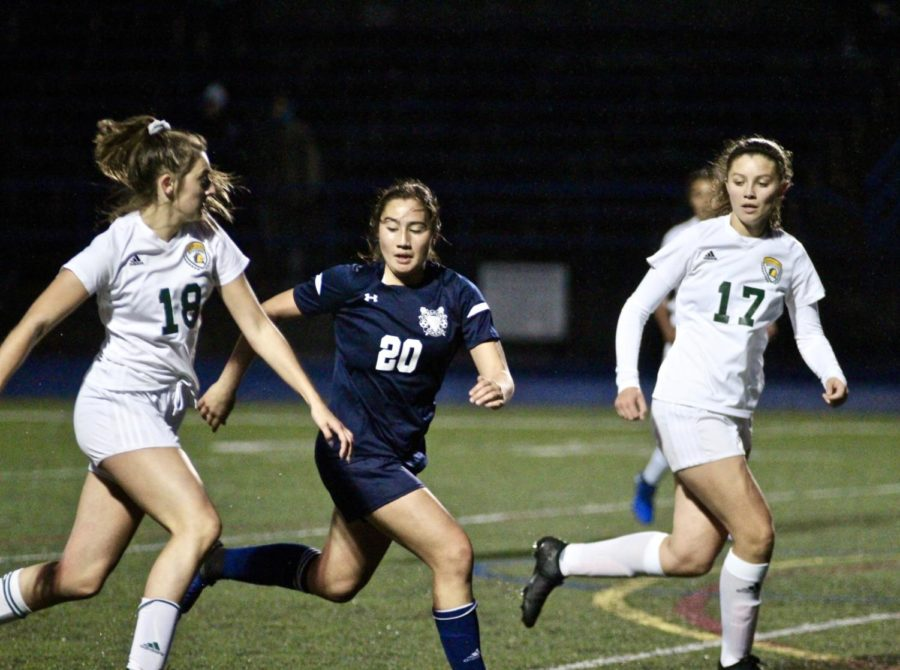 Madeleine Cunningham chases her opponent down the field.