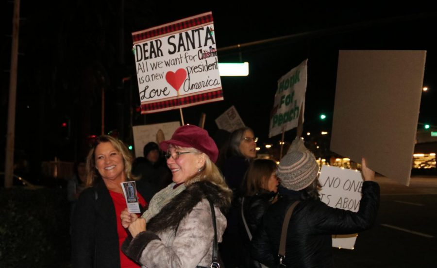 Protestors+hold+sign+that+reads+%22Dear+Santa%2C+all+we+want+for+Christmas+is+a+new+president.+Love%2C+America.%22