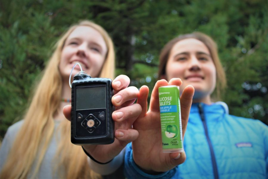 Madeleine Cunningham and Makya Whiting show their insulin pump and glucose tablets.