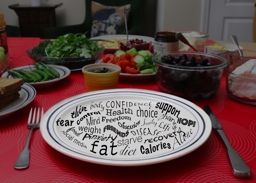 Words associated with disordered eating swim across plate, while food fills the background.