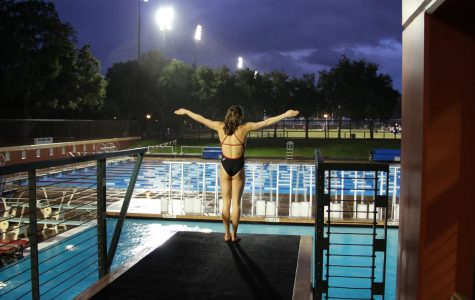 Melina Dimick, a senior, stands at the edge of the platform in preparation for a dive.