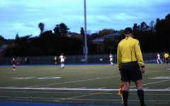 During a high school soccer game, players play without a video assistant referee (VAR).