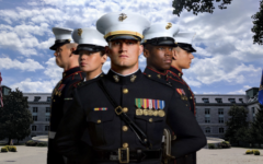 Active US Marines stand in front of the US Naval Academy.