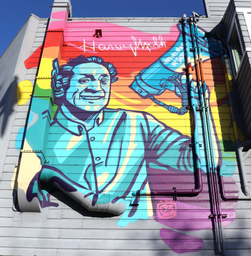 A mural of supervisor Harvey Milk smiles down on pedestrians on the corner of 17th and Castro Street in San Francisco.