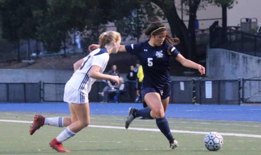 Sam Phan, a senior, dodges the last of three Menlo defenders before scoring her first goal of the game.