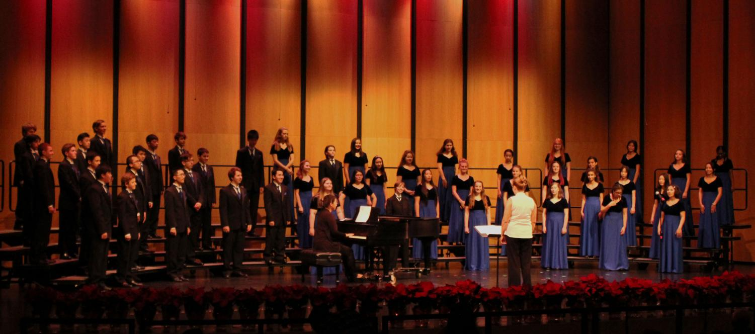 """The Highlanders and Women's Choir stand poised on stage waiting for their next song to begin. """"Performing gives students the confidence to believe in themselves,"""