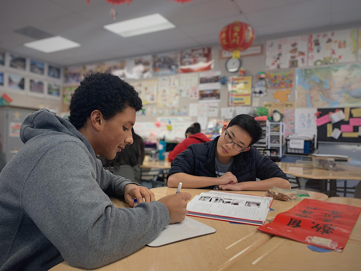 Michael Father and William Wong, co-presidents, focus on perfecting their grammar skills.