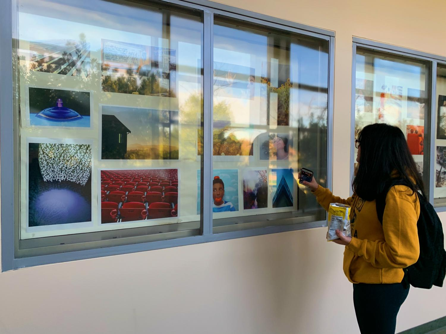 In F Hall, the walls are covered in displays, full of student photos, paintings, and drawings. The walls serve as an exposition of their hard work.
