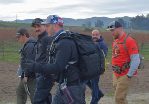 John Preston (center) hikes with a group of local firefighters a week in to his journey.