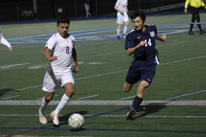 Kai Yoshida, a sophomore, closes in on the ball handler for Sequoia.