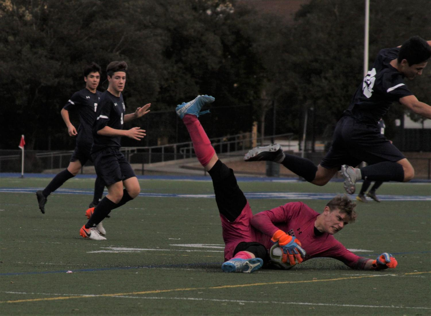 Hillsdale goalkeeper Parker Crouse makes a diving save in the first half.