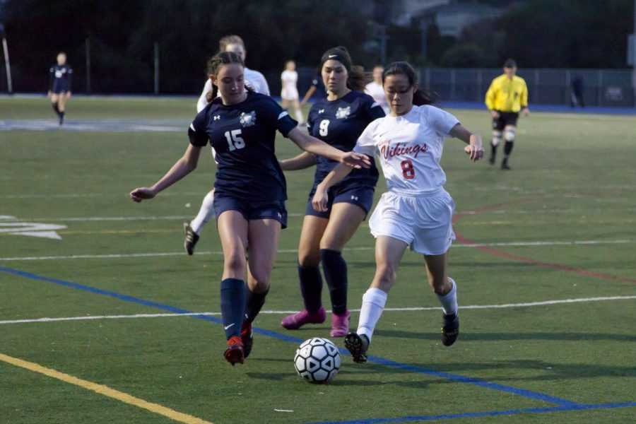 Katie Blondino, a junior, attempts to steal the ball.