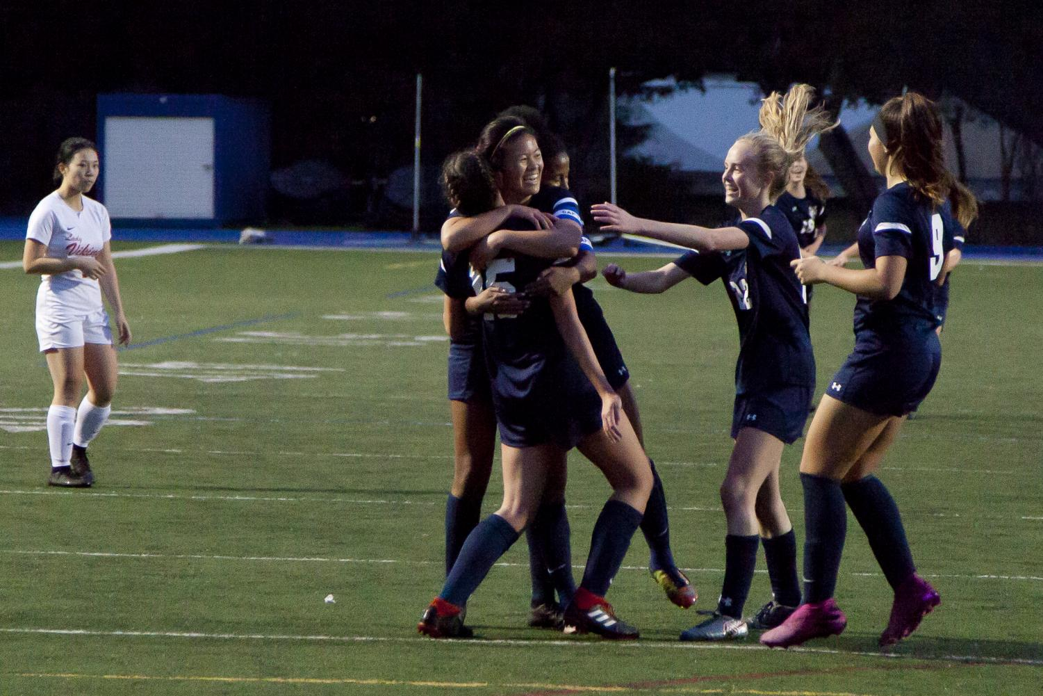 Carlmont celebrates a goal scored by Katie Blondino.