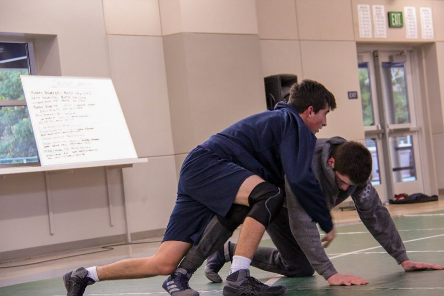 Two+wrestlers+practice+in+the+Student+Union+the+evening+before+the+Shark+Shootout.