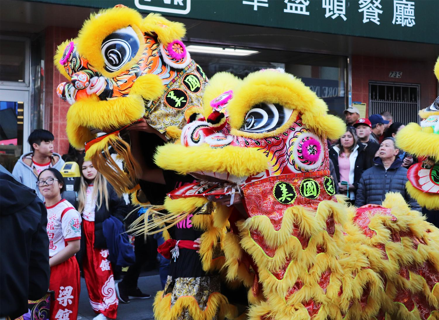 Lion dancers parade through the streets before the ceremony begins.