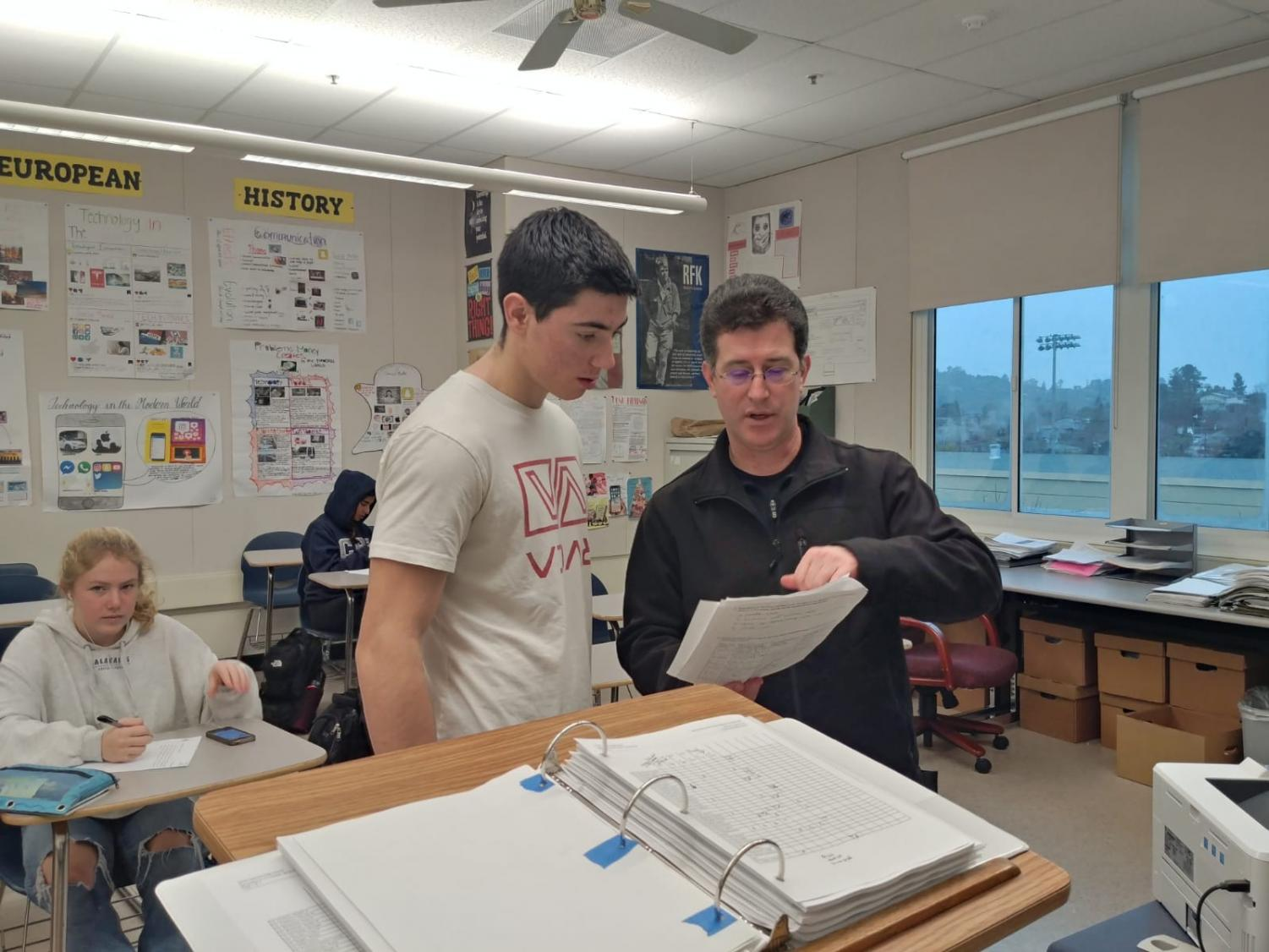 History teacher David Braunstein helps a student with a homework assignment during the Flex period.