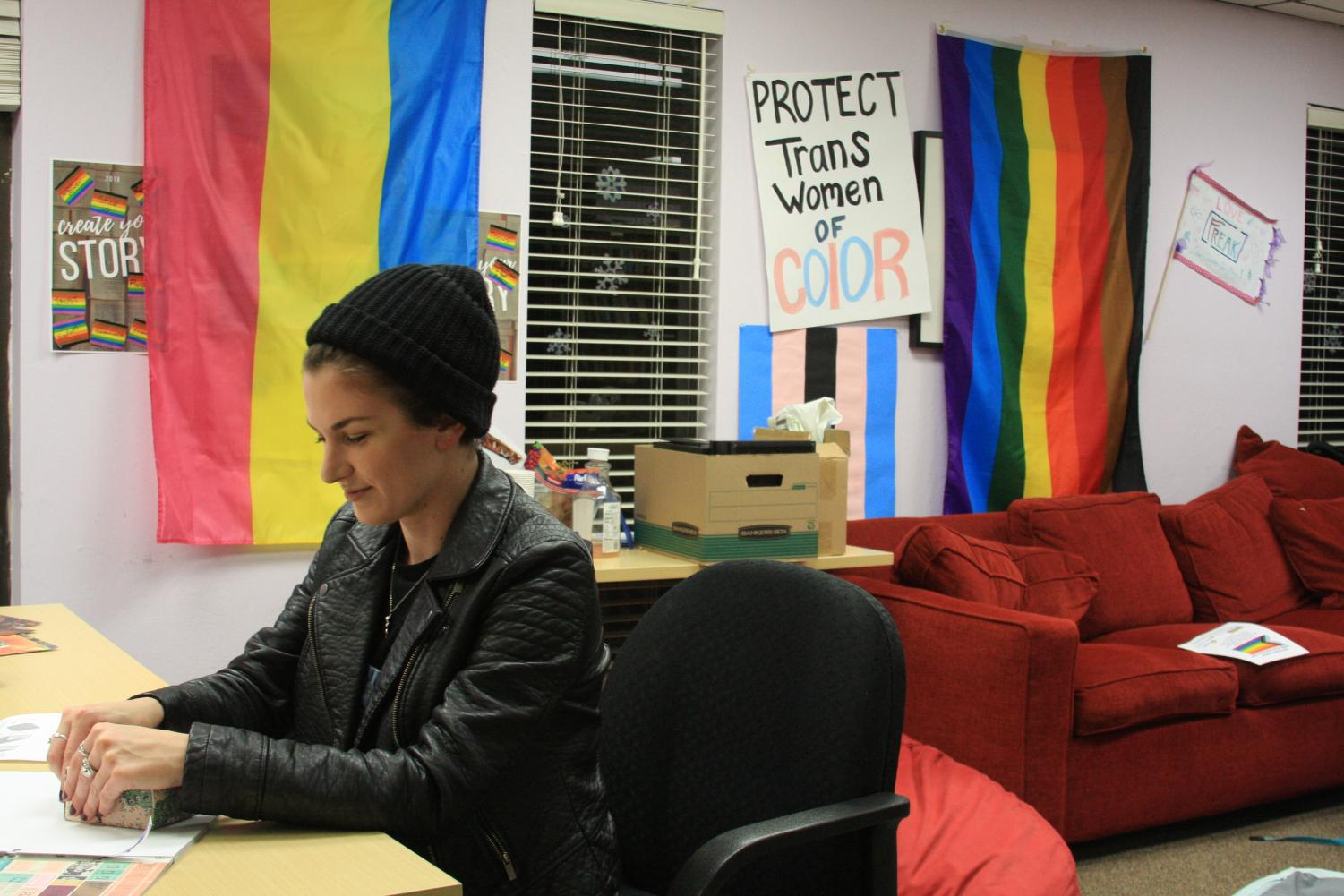 Alexis Spalding, an intern at the San Mateo Pride Center, demonstrates how to fold paper boxes during the LGBTQ+ Youth Group.