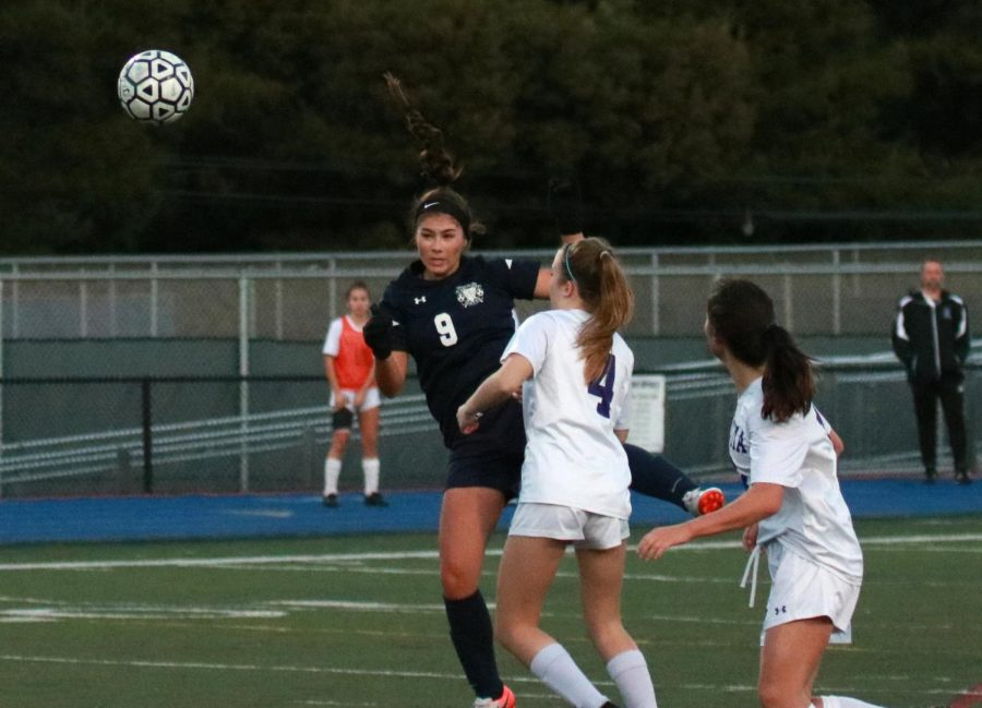 Kyla+Orthbandt%2C+a+senior%2C+heads+the+ball+towards+the+goal+in+the+first+half.