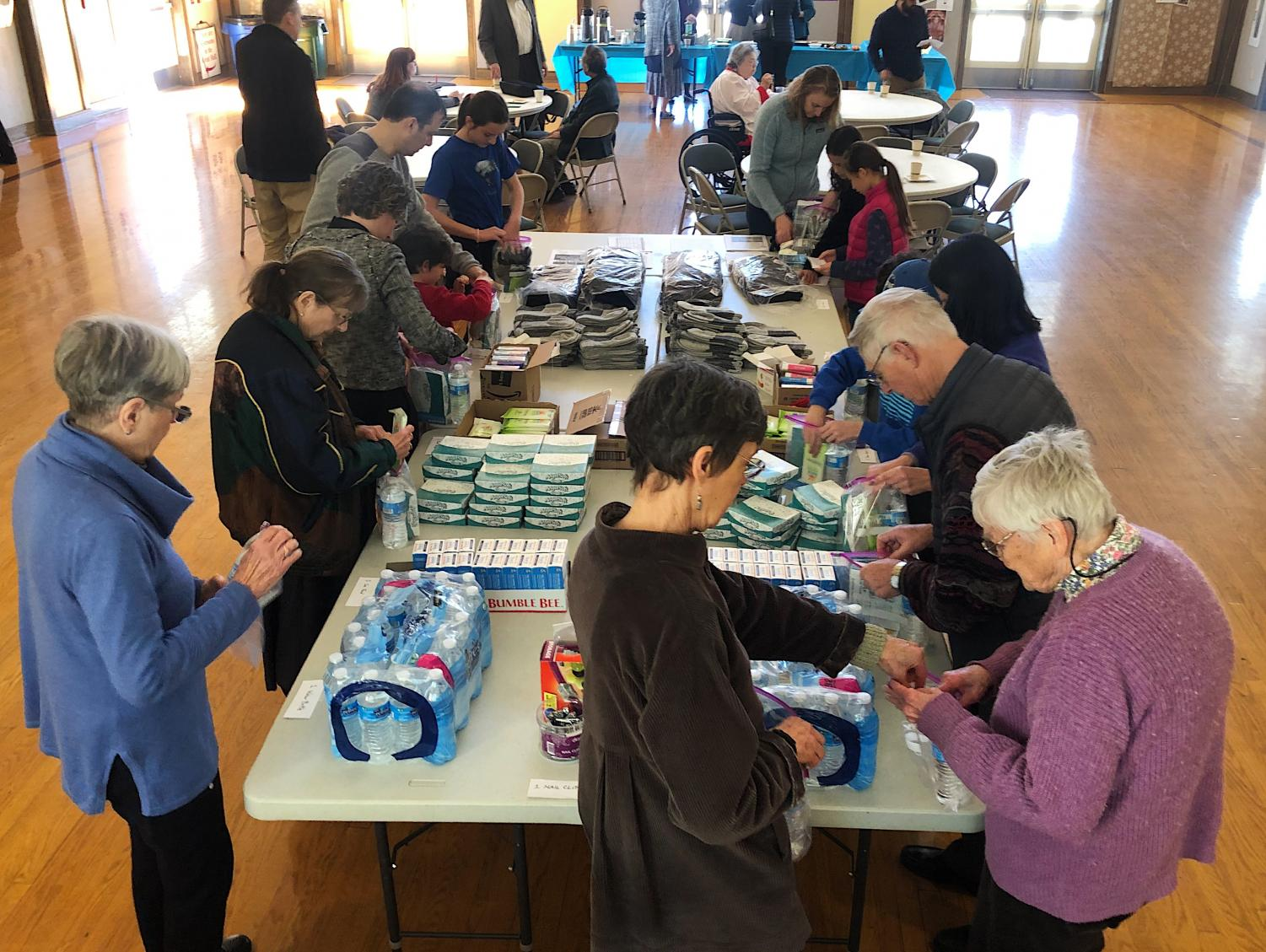 Volunteers work to create homeless care packages throughout the morning.