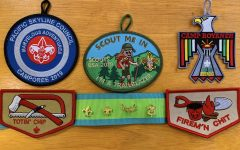 Temporary patches and pins signify key points in a Scout's journey, whether they are rank advancements or events.