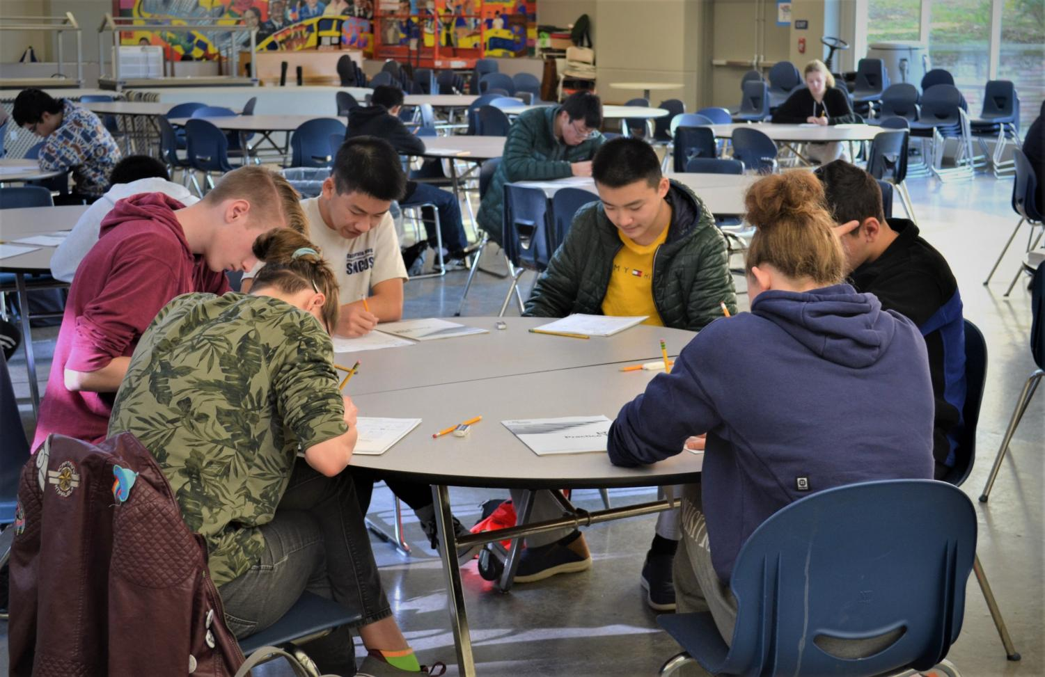 Students fill in their personal information before beginning the mock SAT in the Student Union on Feb. 1.