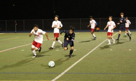 Danny Wilson, a senior, races a Mt. Pleasant defender to the ball during the second half. Mt. Pleasant would defeat Carlmont 2-0 to advance to the semifinals of Division II CCS.