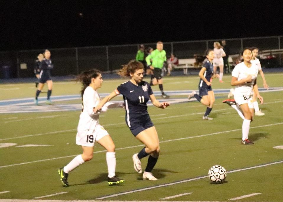 Lara Craciun, a sophomore, pushes the ball up the field in hopes to score.