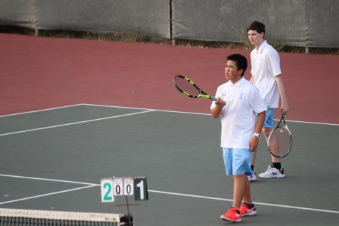 Hillsdale players are dissatisfied with a call during their match.