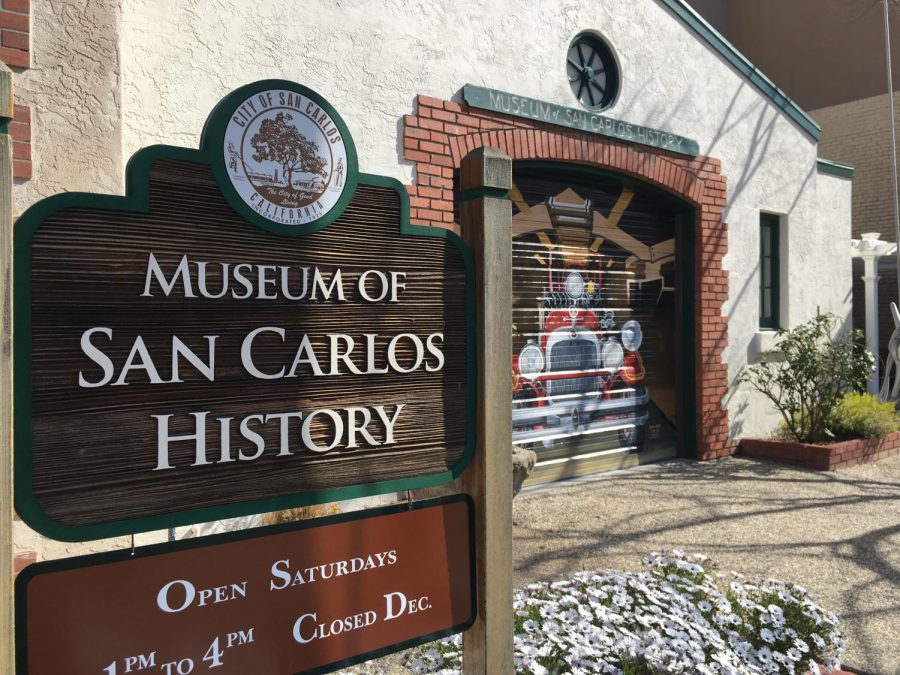 A sign with the seal of San Carlos,