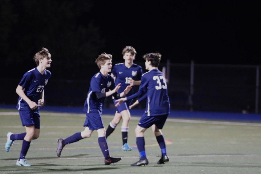 Justin+Eliason%2C+a+sophomore%2C+celebrates+with+his+teammates+after+scoring+a+goal.