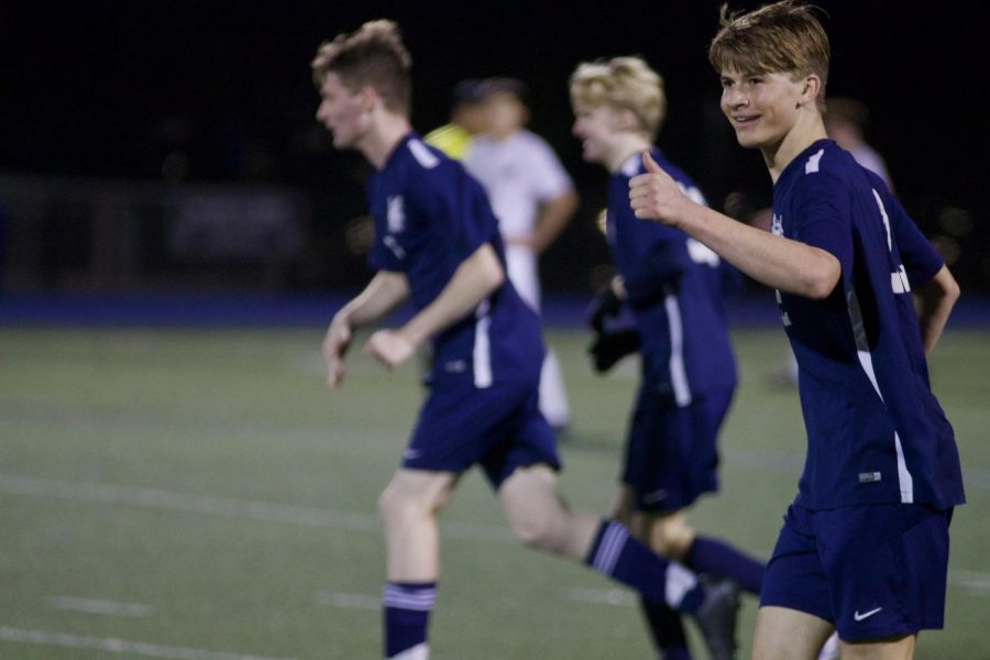 Sophomore+Max+Klar+celebrates+his+team%27s+victory.