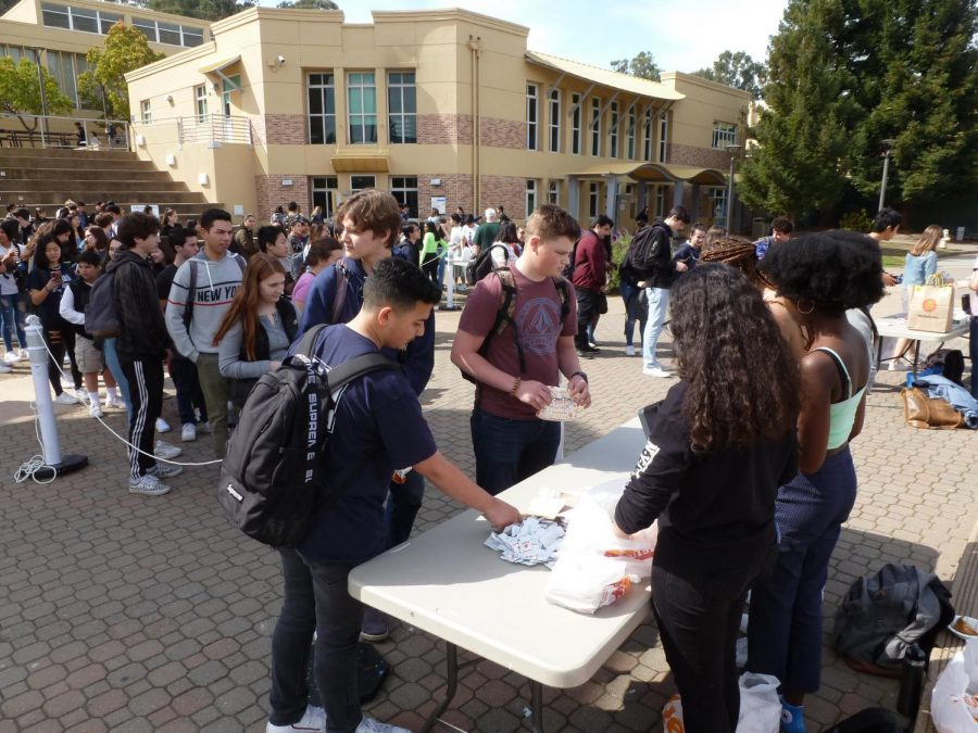 Students wait in long lines to buy food at the Heritage Week's food sale, which is designed to showcase various ethnic foods.