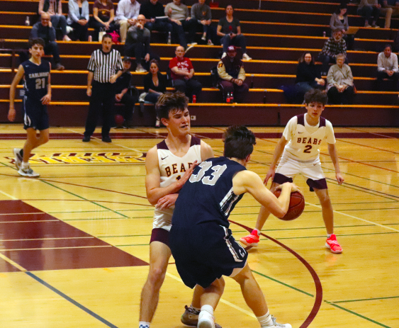 Sophomore Tripp Garrish backs down his defender on the perimeter.
