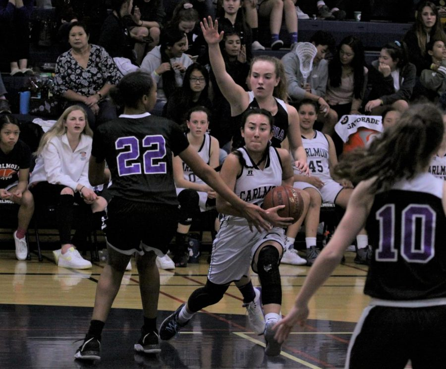 Erica Mendiola, a senior, moves past Sequoia defenders on her way to the basket.