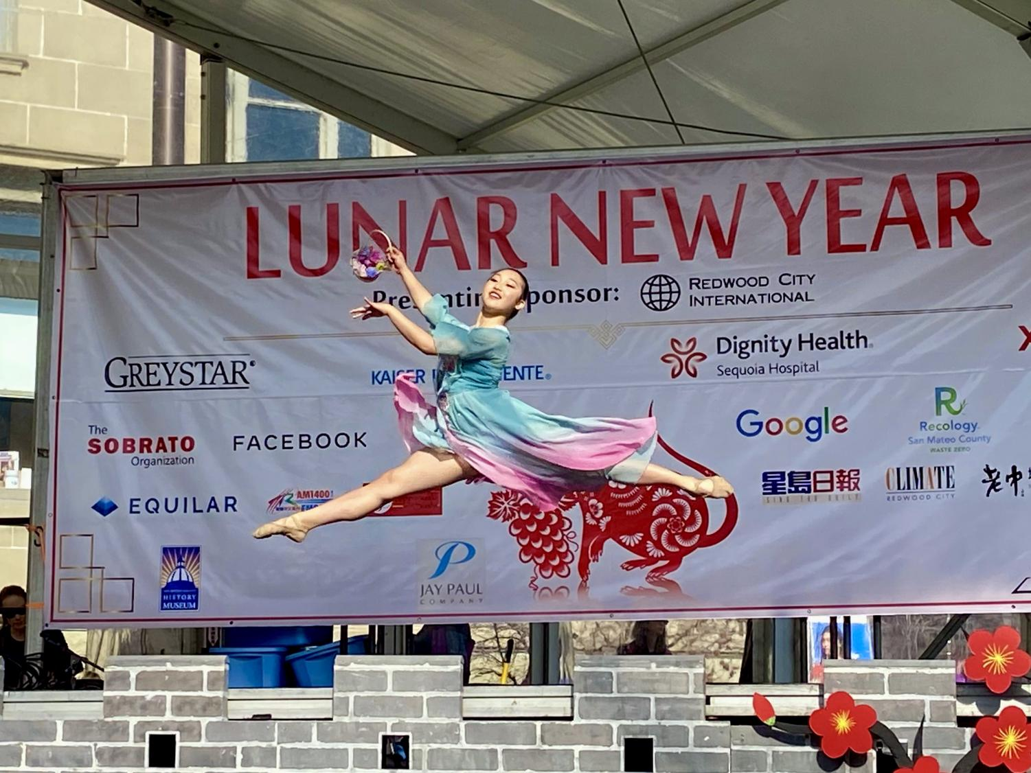 A performer performs a traditional Chinese  dance at the annual Redwood City Chinese New Year event.
