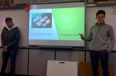 Club President Thaddeus Duffy and Vice President Tej Tummala teach club members about cryptocurrency, a digital currency that people obtain for different purposes.