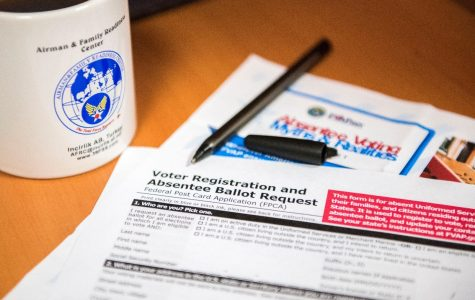 A voter registration and absentee ballot lies on a table in the Airman and Family Readiness Center.
