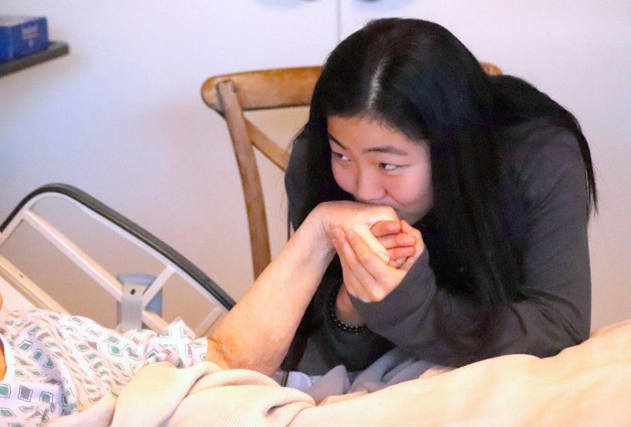 Emily Kim spends time with one of the patients at Mission Hospice.