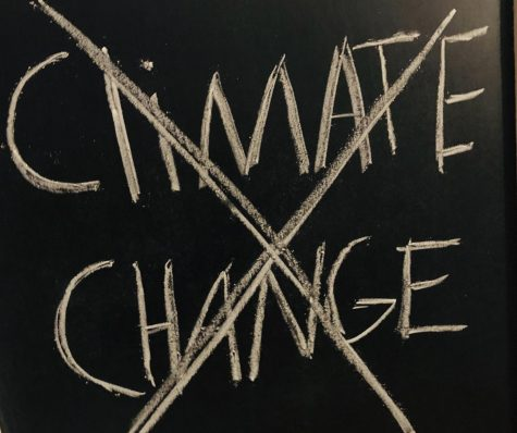 The chalkboard symbolizes the ignorance of climate change in education.