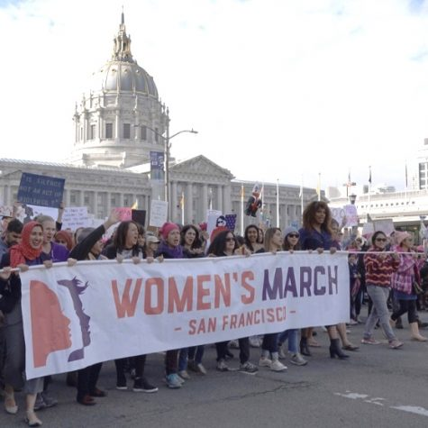 """Honey Mahogany marches on the front lines of San Francisco's 2020 Women's March. """"Honey continues to organize and fight for the most vulnerable communities in San Francisco every day as a legislative aide in the District 6 Office, and hopes to be able to continue her service on the SF DCCC [Democratic Congressional Campaign Committee] as an elected member,"""" Mahogany said on her website."""
