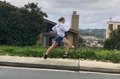 Emma Scott runs through her neighborhood as part of her '80s montage video.