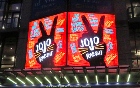 """Jojo Rabbit"" premiers in movie theaters, drawing in viewers with bright colors and its distinctive peace sign."