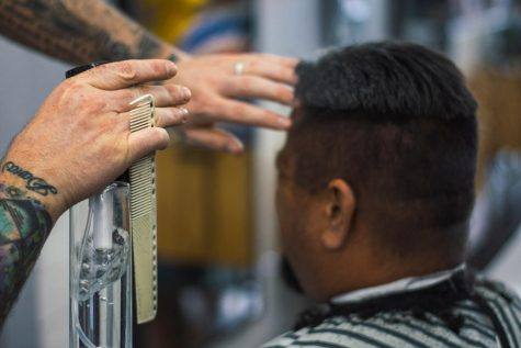 Travis Sweeney: Helping the community through cutting hair