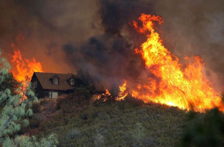 A+2017+wildfire+approaches+a+house+in+Northern+California.