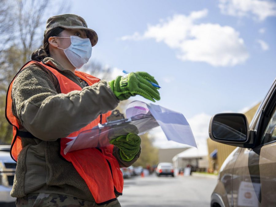 The New York National Guard distributes people through vehicles, at the feeding Westchester, who have distributed more than 2.5 million pounds of food to surrounding communities since the COVID-19 Pandemic began.