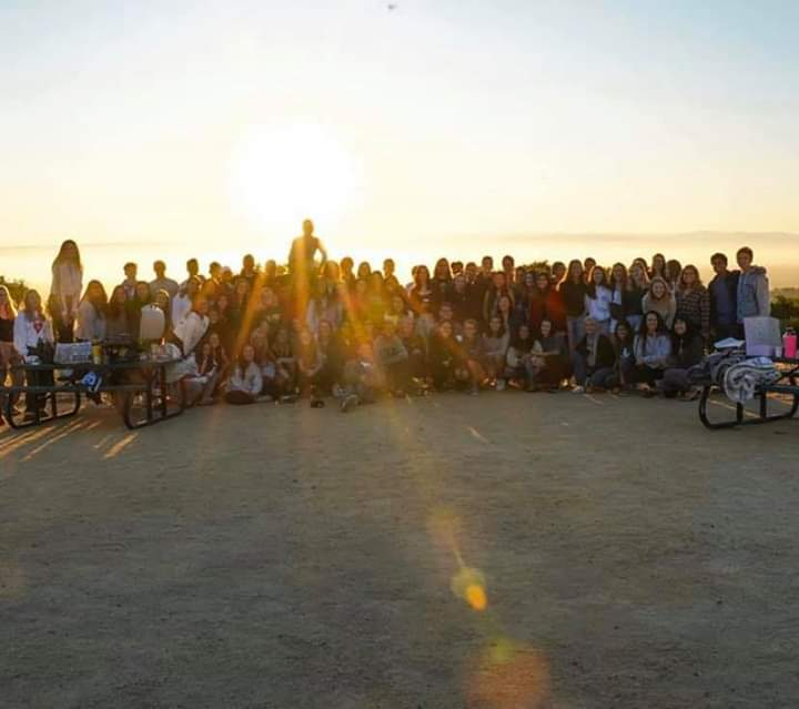 The+Class+of+2020+poses+and+smiles+for+their+senior+sunrise+photo.