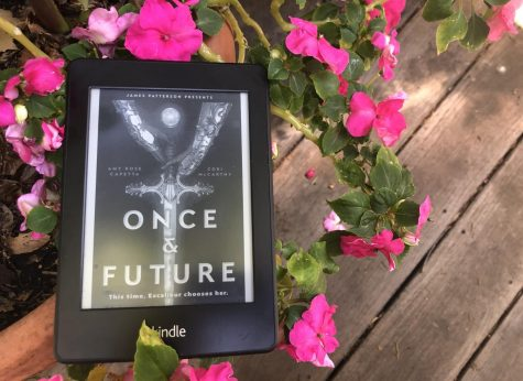 """Once and Future"" by Amy Rose Capetta and Cori McCarthy is a book that retells the story of Arthur and the Round Table with a futuristic twist."