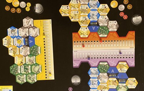 Players place building tiles in their boroughs to get income, reputation, and population in their city.
