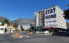 A billboard in Cape Town, South Africa, tells residents to stay home to prevent the spread of COVID-19.