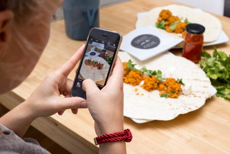It has become common on social media to post pictures of experiences or food.